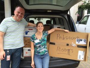 Labor Archivist Jennifer Eidson packs up boxes with Pride at Work's Executive Director Jerame Davis.