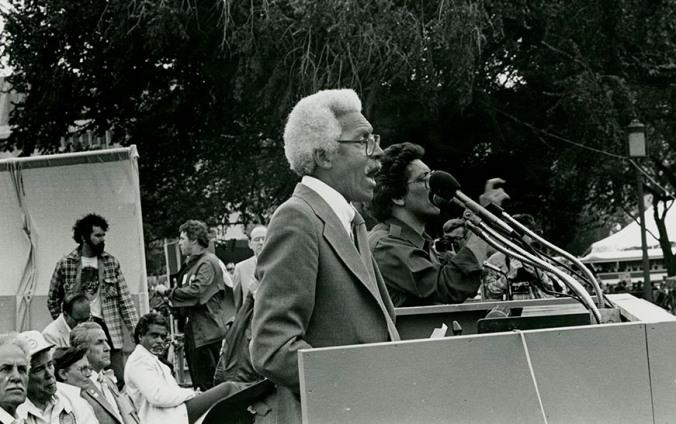 Photo of Bayard Rustin speaking at Solidarity Day