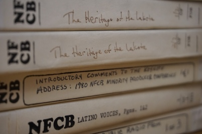 Photo of stack of audio reel boxes from NFCB