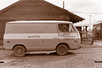 "UMUC Van with hand lettering on the side - ""University of Maryland Wants You, Army Education Center"""
