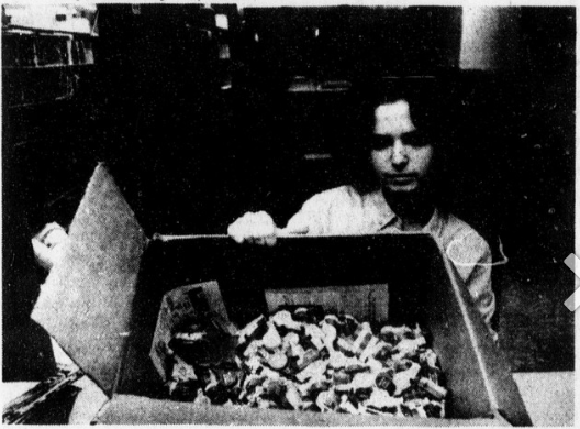 Image of student Sharon Cohen with a box of rape whistles